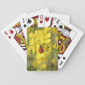 Coccinelle jaune de rouge de bonne chance de fleur jeux de cartes