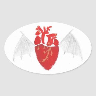 Coeur avec les ailes déchirées en lambeaux sticker ovale