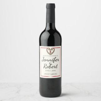 Coeur celtique avec un étiquette rouge de vin rosé
