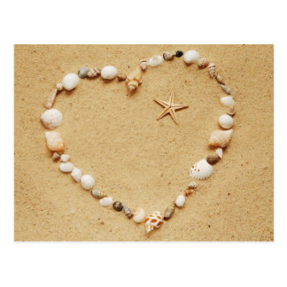Coeur de coquillage avec la carte postale d'étoile