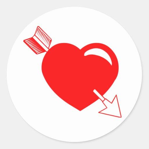 Coeur de rouge de la flèche du cupidon autocollant rond