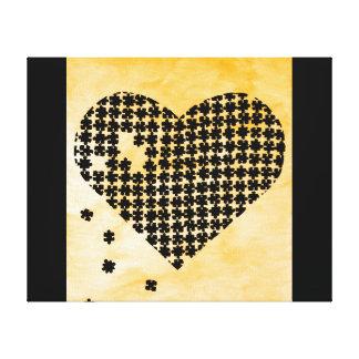 Coeur orange de puzzle toile tendue sur châssis