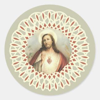 Coeur vintage de Jésus avec la frontière Sticker Rond