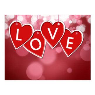 Coeurs accrochants d'autocollant d'amour - carte