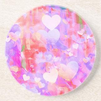 Coeurs de couleur d'eau dessous de verres