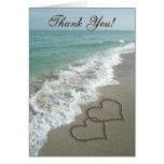Coeurs de sable sur la plage, cartes de Merci
