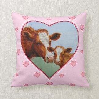 Coeurs rose-clair de vache et de veau à Guernesey Oreillers