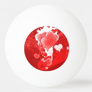 Coeurs rouges avec des ailes balle tennis de table