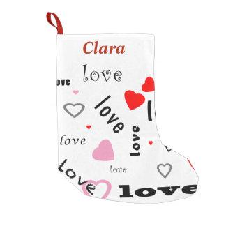 coeurs rouges et roses d'amour de conception des petite chaussette de noël