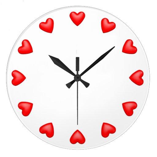 Coeurs rouges sur le blanc horloges