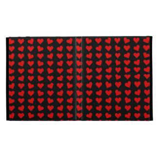 Coeurs rouges sur le coque ipad noir