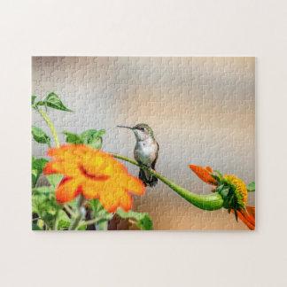 Colibri sur un plante fleurissant puzzle