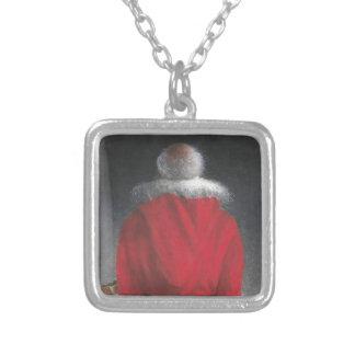 Collier Homme dans le manteau rouge