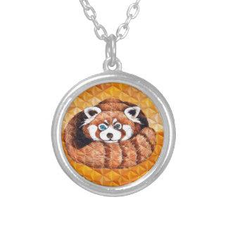 Collier Le panda rouge concernent le cubisme orange