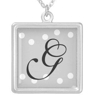 Collier noir blanc argenté du monogramme G de poin