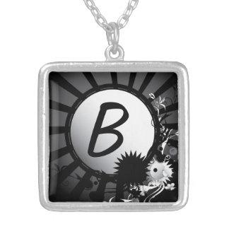 Collier radial noir et blanc du monogramme  