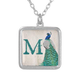 Collier turquoise de monogramme de Turquo de plume