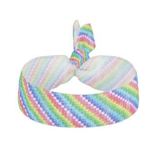 Coloré dans des carrés de papier de graphique élastiques à cheveux