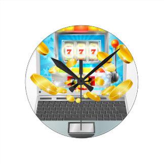 Concept d'ordinateur portable de machine à sous horloge ronde