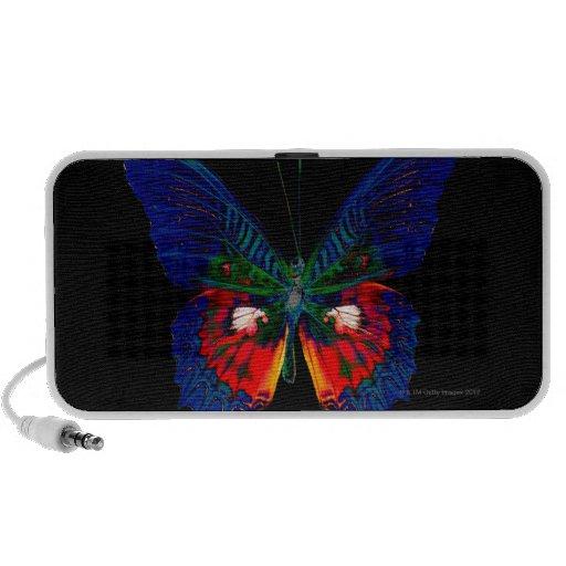 Conception colorée de papillon contre le contexte  haut-parleurs ordinateur portable