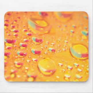 conception colorée lumineuse de gouttelette d'eau tapis de souris