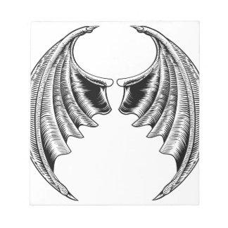Conception d'ailes de batte ou de dragon blocs notes