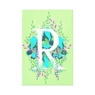 Conception de lettre florale initiale espiègle et toiles