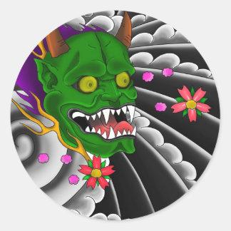 conception japonaise de tatouage de masque sticker rond