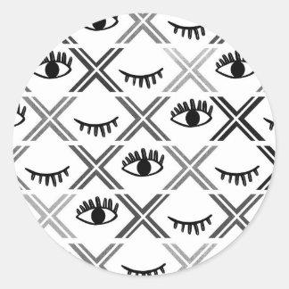 Conception noire et blanche originale de yeux sticker rond