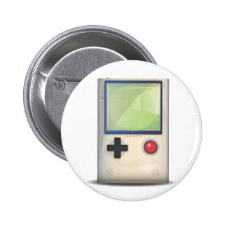 Console tenue dans la main de jeu badge