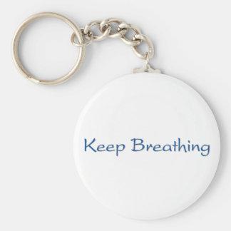 Continuez la respiration porte-clé rond