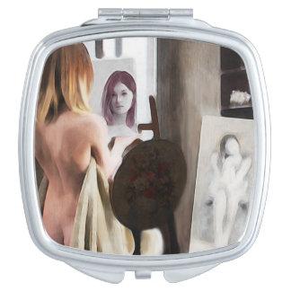Contrat de miroir de femme de réflexions miroir de maquillage