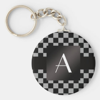 Contrôleurs gris et noirs de monogramme porte-clé rond