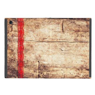 Coque iPad Mini Arrière - plan en bois de texture. Ruban rouge.