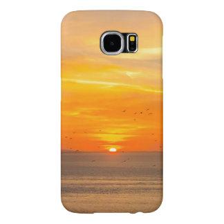 Côte de coucher du soleil avec Sun orange et