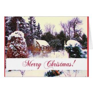 Cottage dans la carte de voeux de Noël en bois