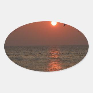 Coucher du soleil de la Sardaigne Sticker Ovale