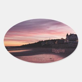 Coucher du soleil de plage de Higgins Sticker Ovale