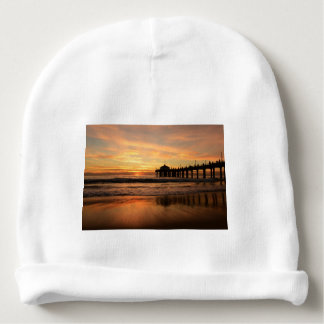 Coucher du soleil de plage de pilier bonnet de bébé