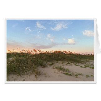Coucher du soleil sur la plage carte de vœux