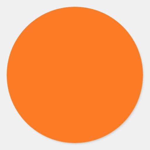 couleur solide orange au néon autocollant rond