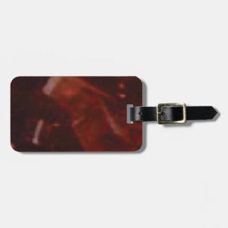 coupe rouge foncé de pierre étiquette à bagage