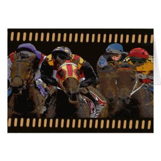 Course de chevaux sur la bande de film carte de vœux