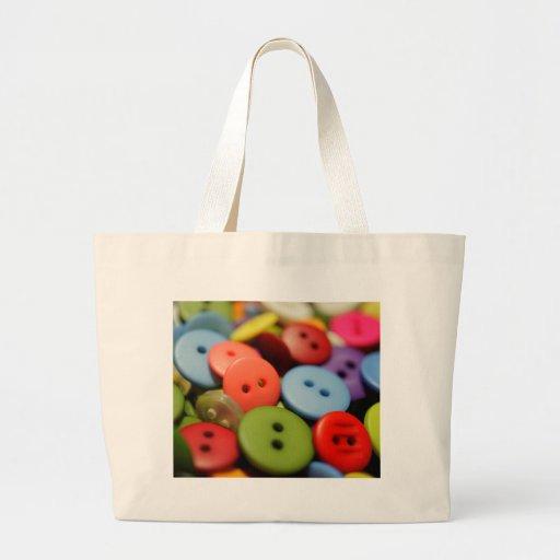 Cousez beaucoup de boutons sacs fourre-tout