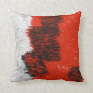 Coussin abstrait gris, de rouge et de noir
