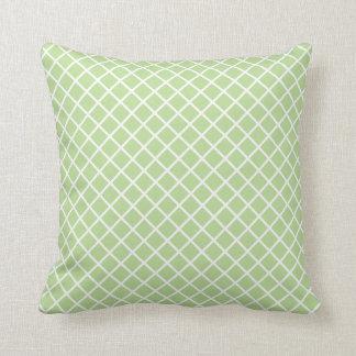 Coussin Contrôles blancs de diagonale sur le vert en bon