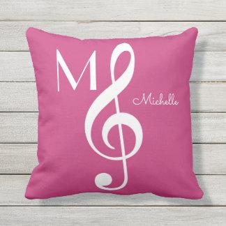 Coussin D'extérieur rose décoré d'un monogramme de note musicale de