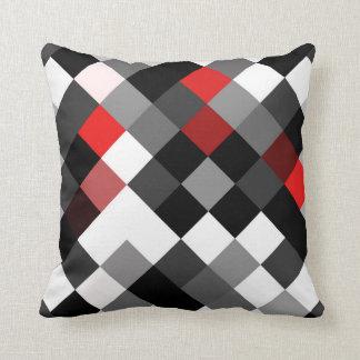 Coussin diagonal rouge blanc noir audacieux de