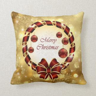 Coussin Guirlande d'or et rouge de Noël avec l'arc et le