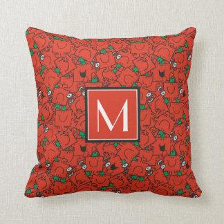 Coussin Poids de levage rouges et monogramme vert du motif